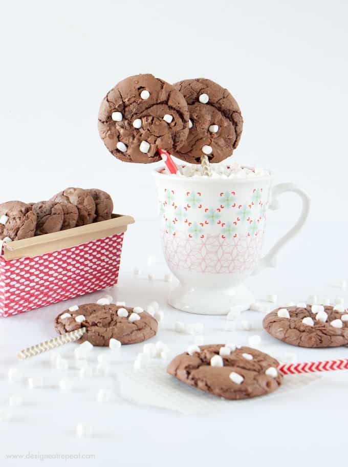 Make these Hot Chocolate Brownie Cookies using a boxed brownie mix & one cup of chocolate cake mix! The cake mix makes them thick, while still keeping a chewy, chocolately texture! Fun way to use those mini marshallows!