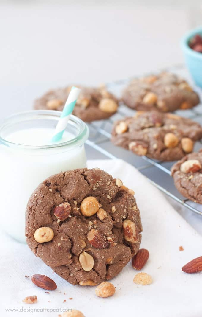 Milk Chocolate Peanut Butter & Almond Cookie leaning against jar of milk.