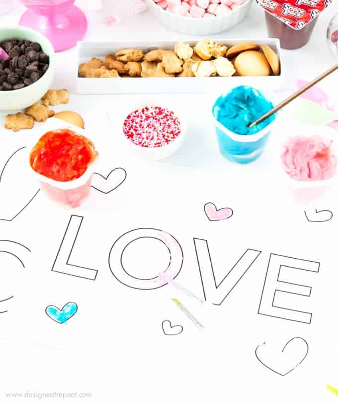 Paint with pudding using these free printable Valetine's Day coloring sheets from Design Eat Repeat!