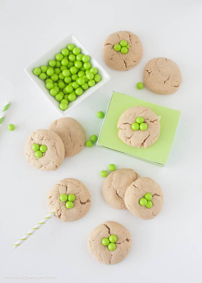 Peanut Butter Shamrock Cookies | Transform a normal peanut butter cookie into a St. Patrick's Day treat by popping green Sixlets on top!
