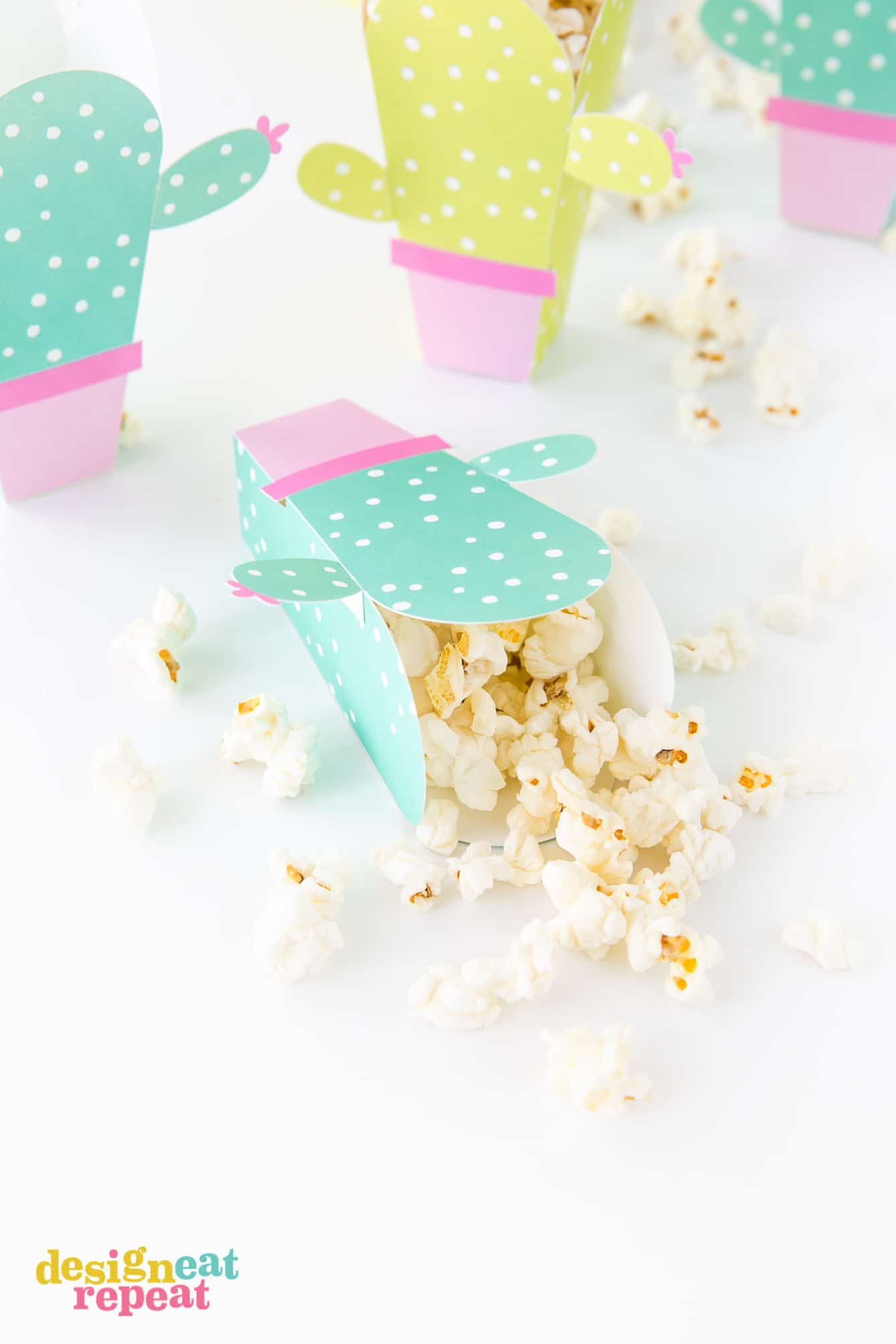 Can these be any cuter?! Cactus popcorn boxes! Get the free popcorn box template at DesignEatRepeat.com | #printable #popcornbox