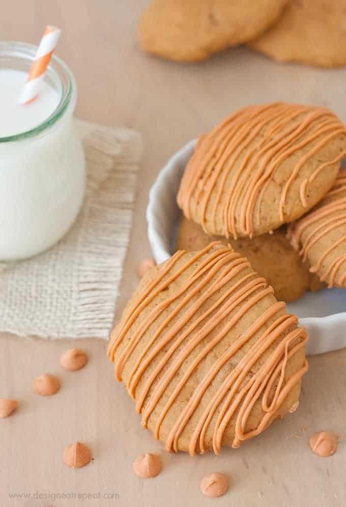Soft Butterscotch Pumpkin Spice Cookies on wooden background with jar of milk