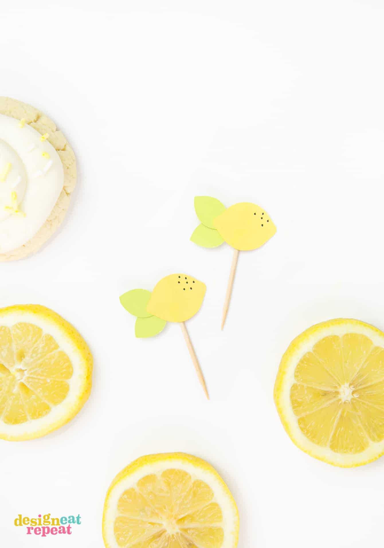 Lemon toppers on toothpicks to decorate thick lemon sugar cookies.
