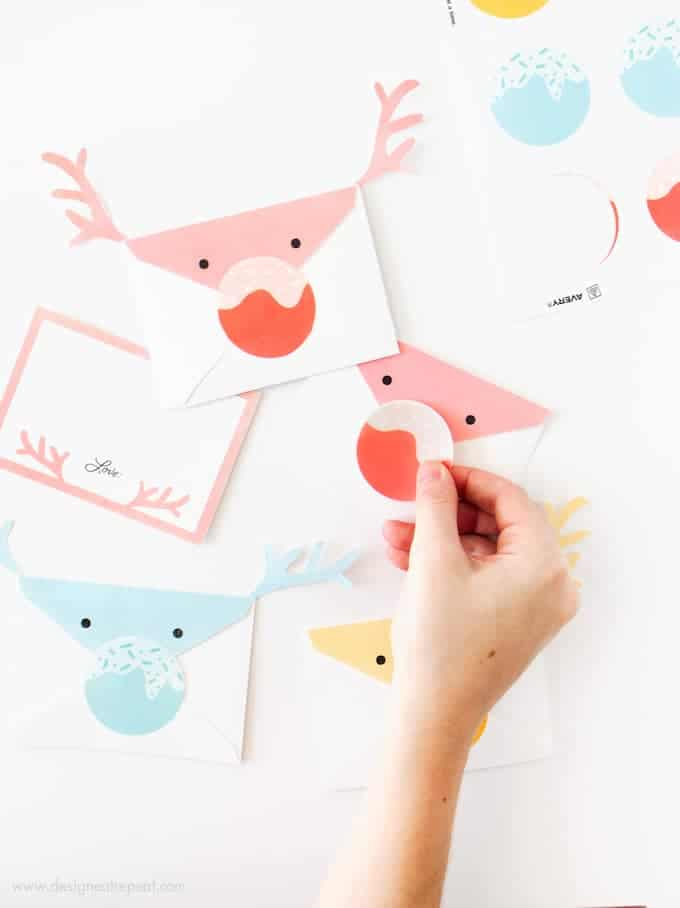 These reindeer envelopes are so adorable and easy to make with the printables from Design Eat Repeat! The entire set is free and comes with the envelope, notecard, and sticker nose template! Such a fun idea for kids!