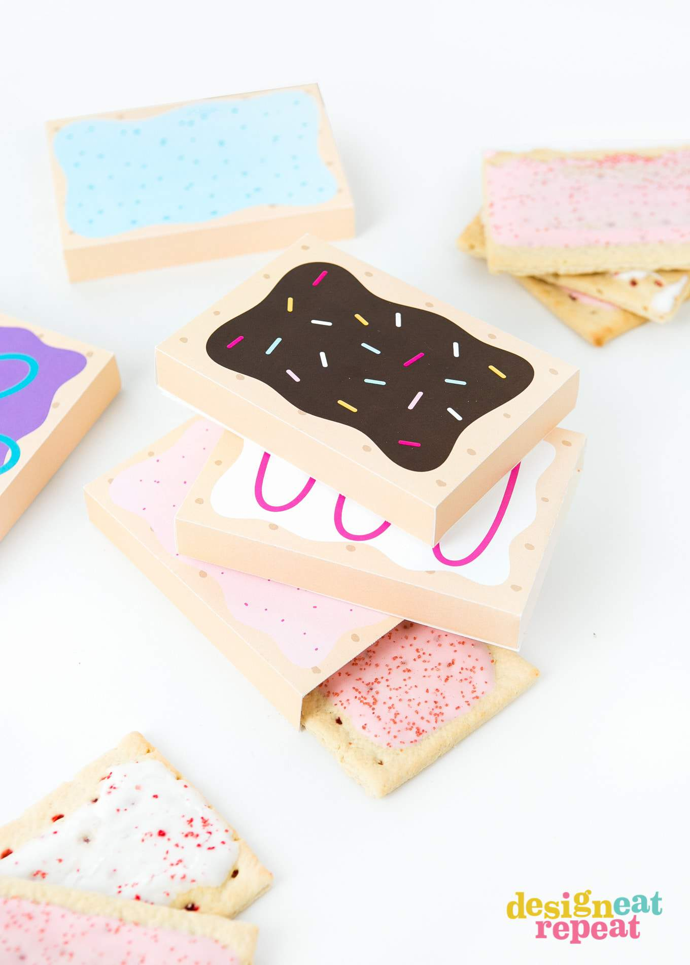 How fun are these?! Printable POP-TART treat boxes! With 8 delectable designs, these gift box templates are sure to please your party goers with their flavor of choice! Download at DesignEatRepeat.com | #printable #silhouette