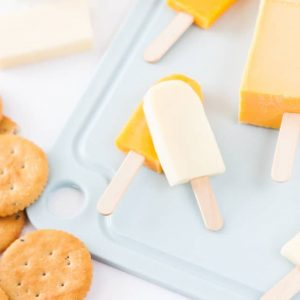 Turn cheese slices into mini popsicles with this fun cheese board idea! So fun!