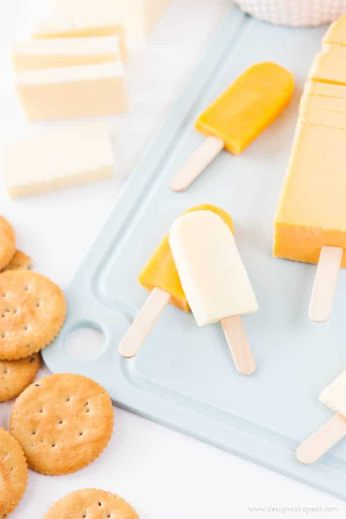 Turn cheese slices into mini popsicles with this fun cheese board idea!