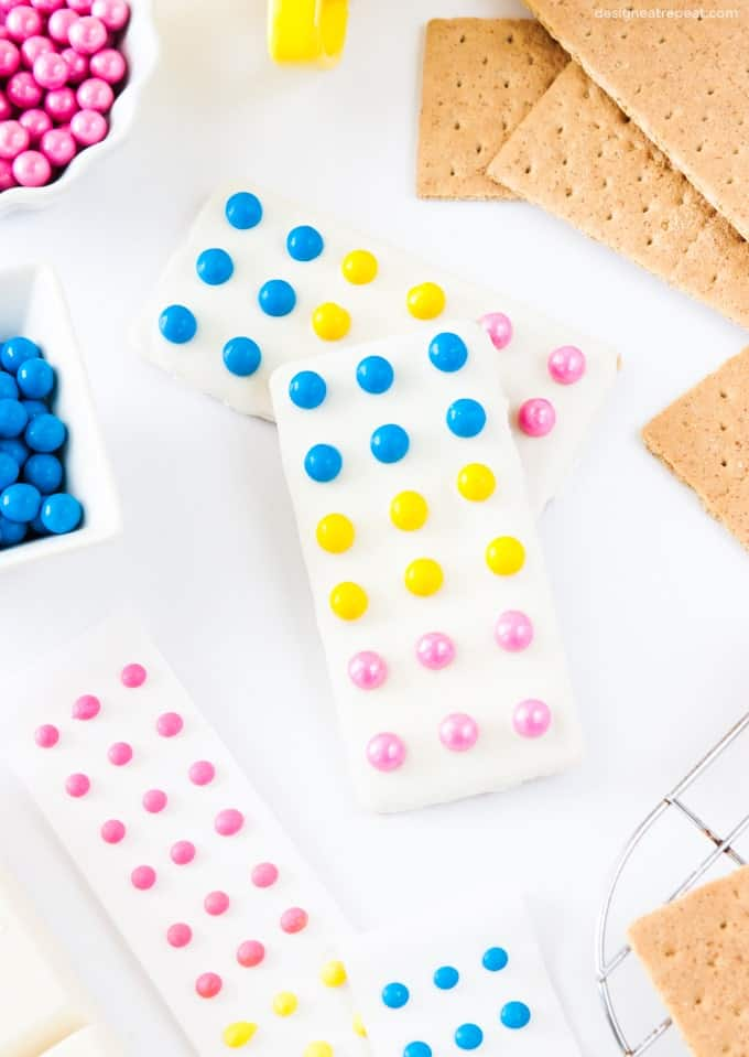 Turn graham crackers into candy button bars with almond bark & Sixlets!