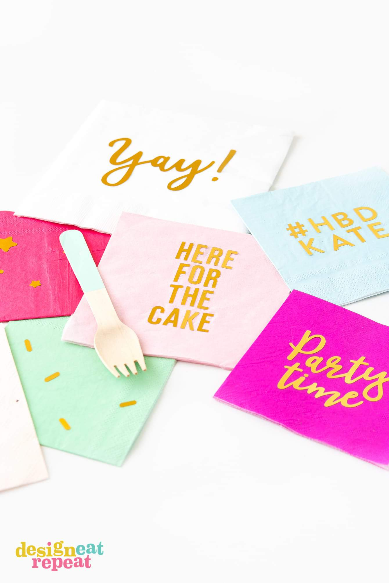 "Pink gold foil DIY napkins that say ""here for the cake"", ""yay"", and ""party time""."
