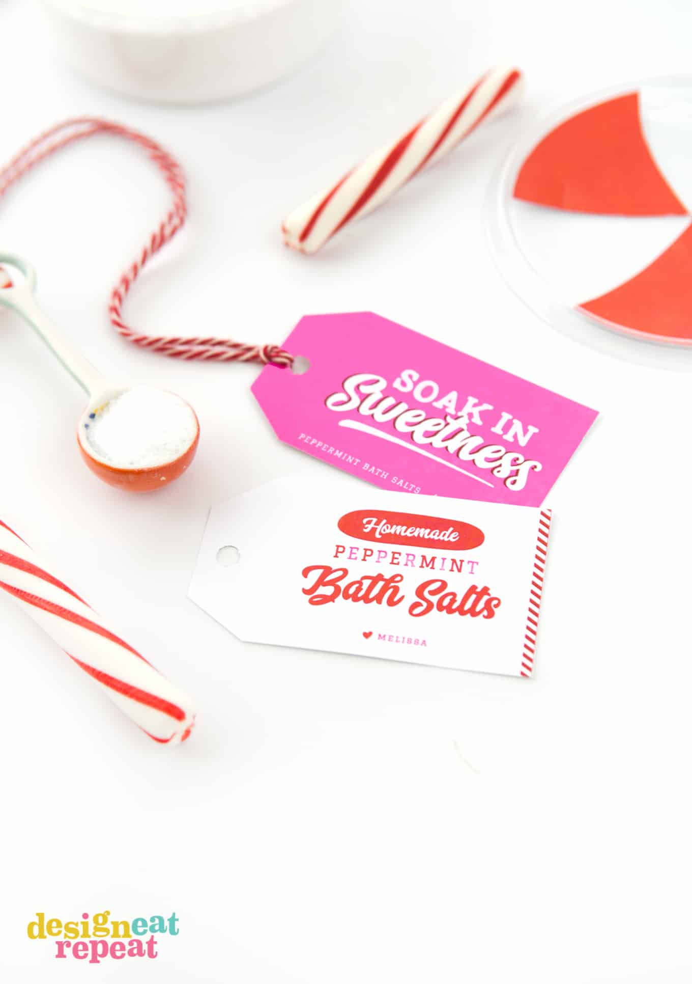 """White and pink printable gift tags for peppermint DIY bath salt. Phrases are """"Homemade Peppermint Bath Salts"""" and """"Soak in Sweetness"""""""