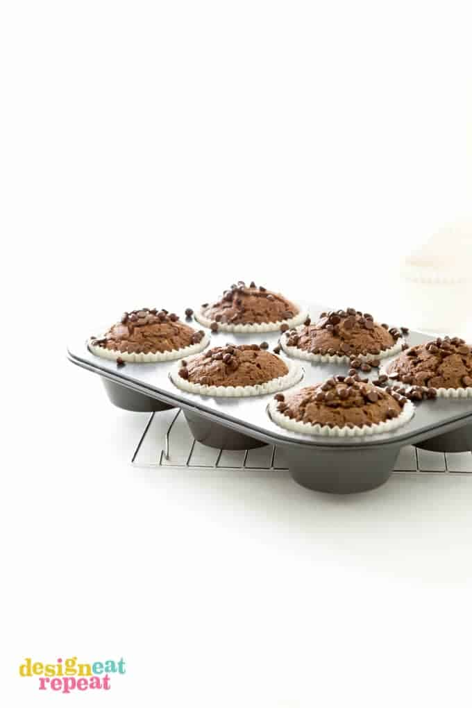 Jumbo cupcake pan filled with six baked chocolate zucchini muffins.