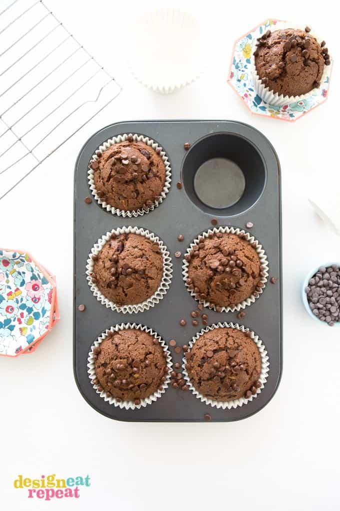 Overhead shot of six Sumbo Double Chocolate Zucchini Muffin in cupcake pan.