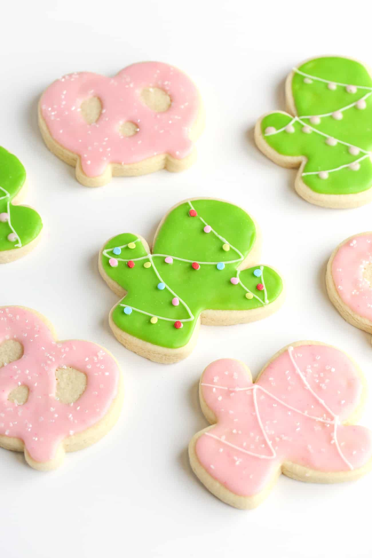 Christmas cactus green sugar cookies, pink cactus sugar cookies, and pink pretzel sugar cookies.