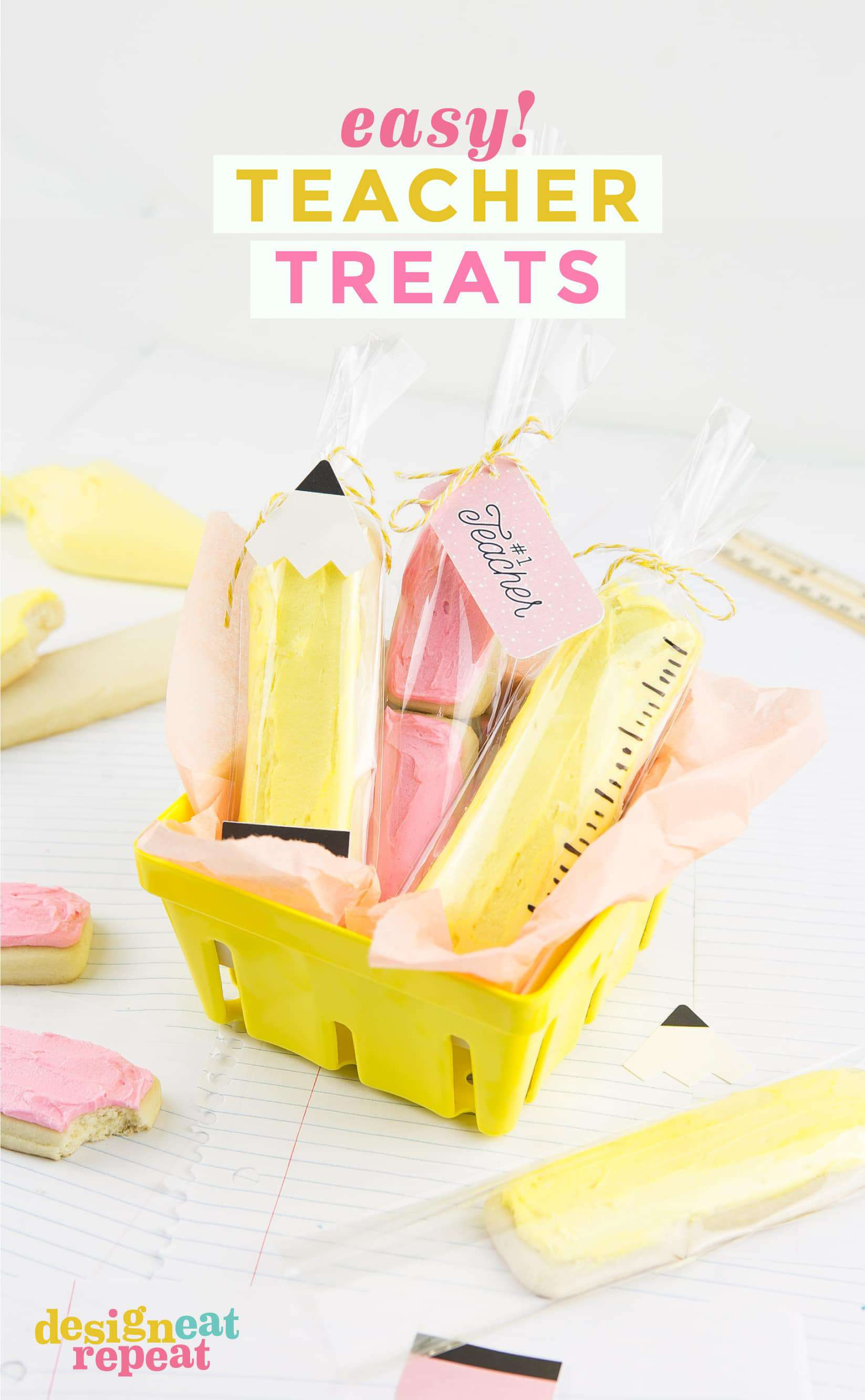 Yellow berry basket of sugar cookie sticks decorated like a pencil, eraser, and ruler.