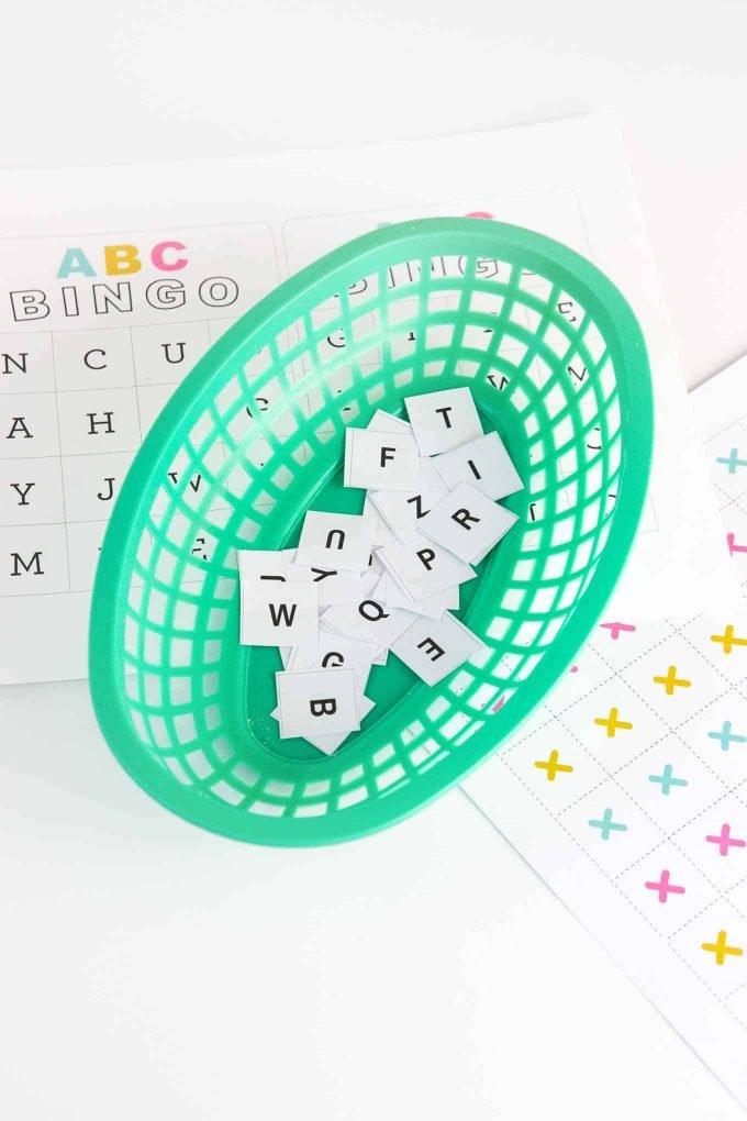 Green basket of alphabet bingo caller squares