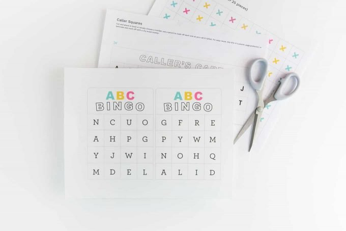 Materials to make alphabet bingo cards. Includes printables and scissors