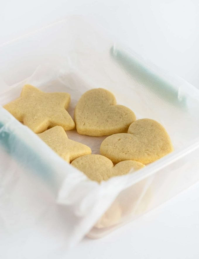 Container of shaped baked sugar cookies