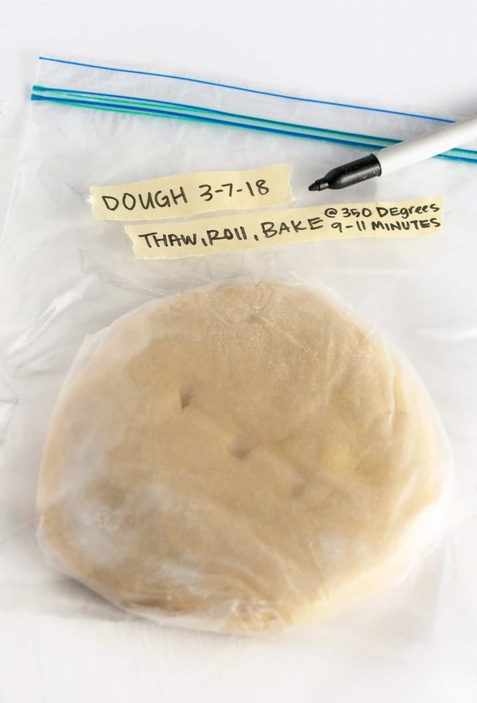 Plastic bag of sugar cookie dough disc with tape notes