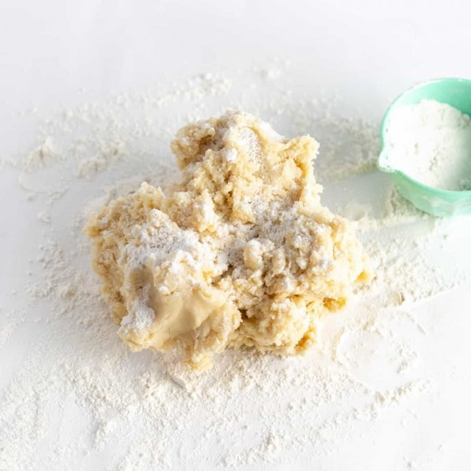 Ball of sugar cookie dough with flour