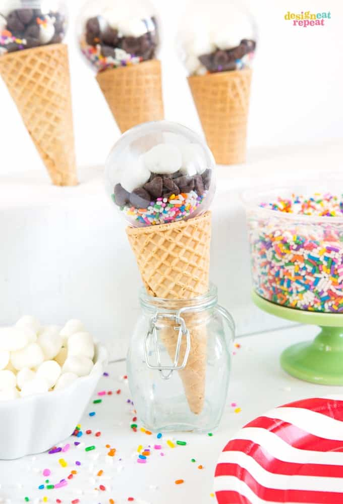 Fill plastic balls with your favorite toppings for a fun way to allow guest's to personalize their bowl of ice cream! Perfect ice cream party favors!