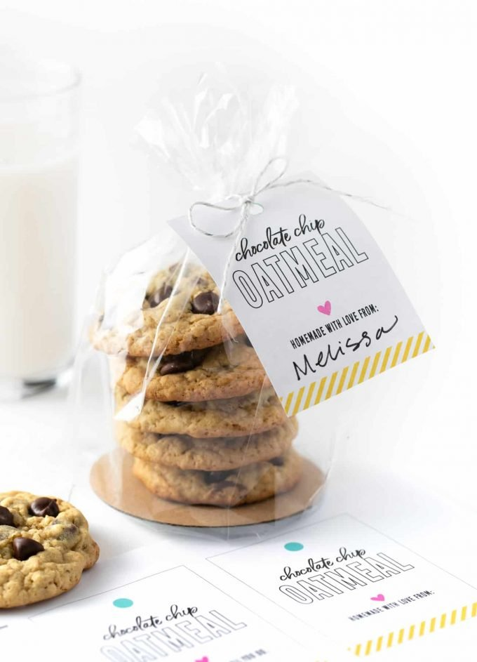 "Stack of chocolate chip oatmeal cookies in plastic bag tied closed with a tag that says ""chocolate chip oatmeal cookies, homemade with love from Melissa"""