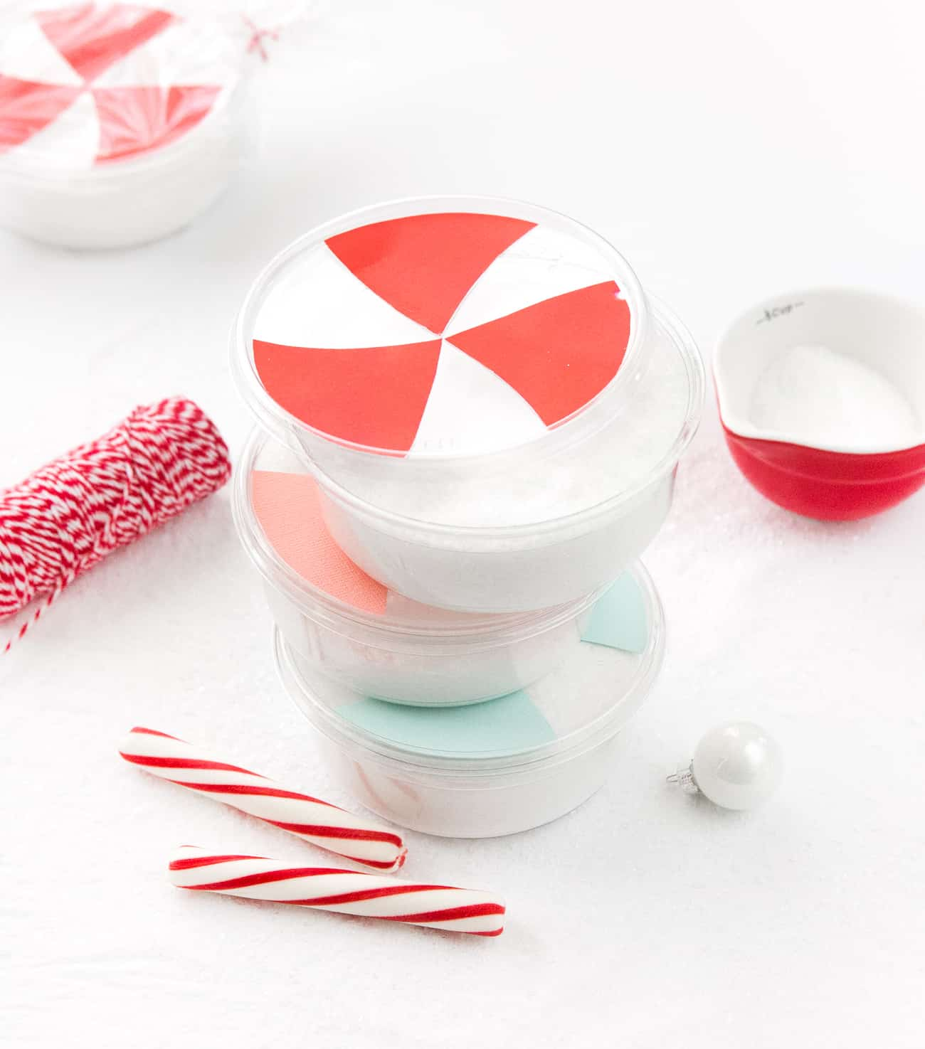 Containers of peppermint DIY bath salt decorated as peppermint candy.