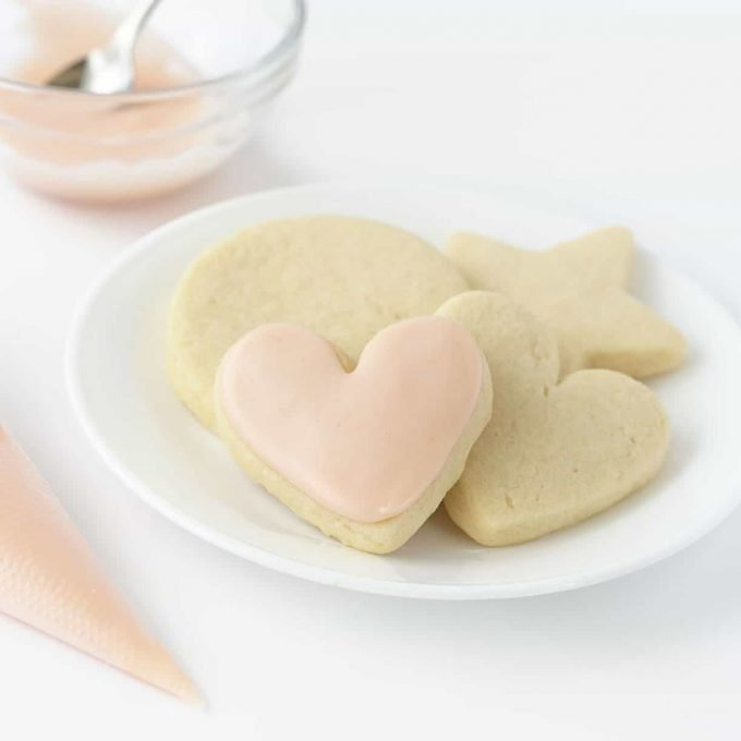 plate of sugar cookies with pink heart