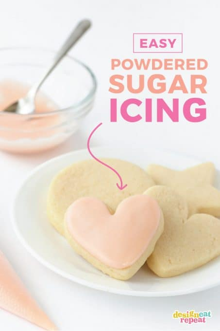 plate of heart sugar cookies with powdered sugar icing for cookies