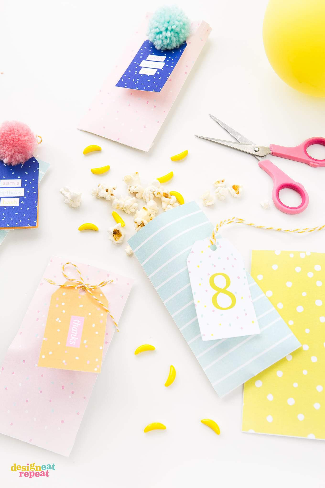 Pink, peach, blue, and yellow party favor bags with matching printable gift tags.