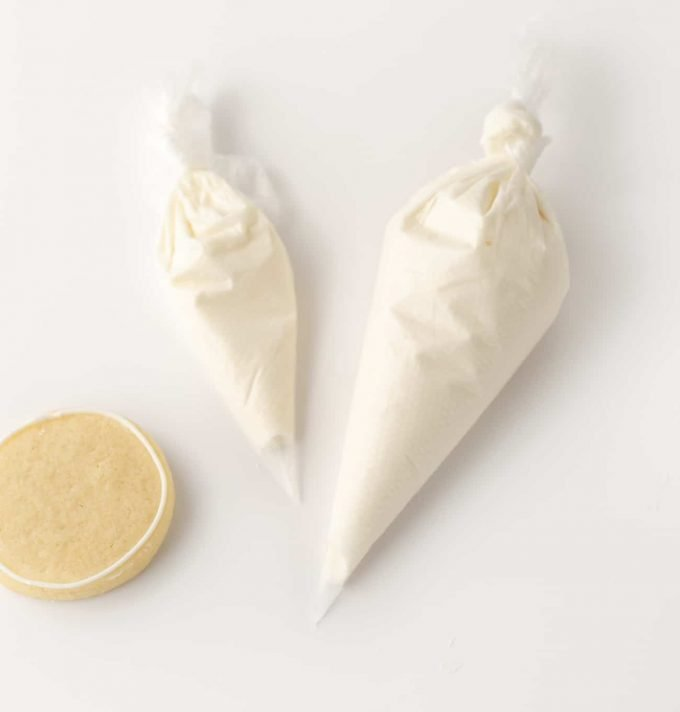 Piping bags with white Royal Icing for Sugar Cookies