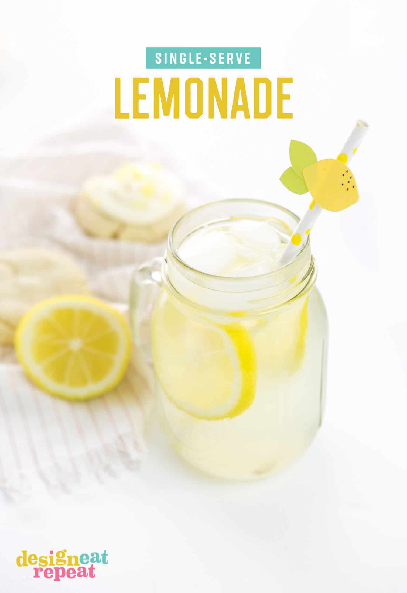 Mason jar of freshly squeezed lemonade with paper straw and lemon topper.