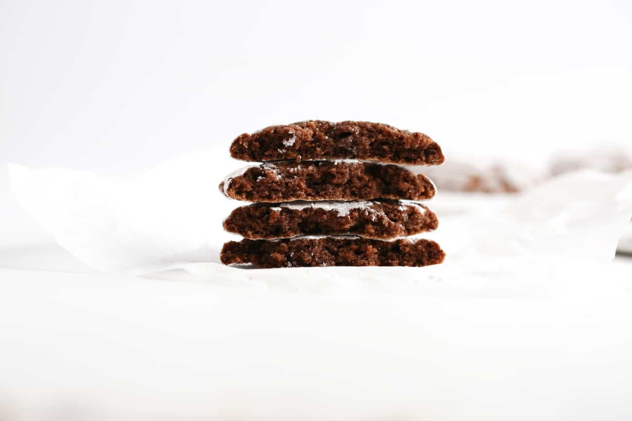 Stack of chocolate brownie cookies cut in half.