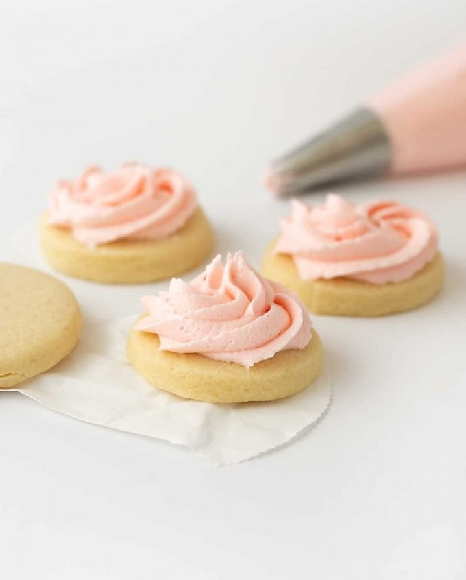 Pink sugar cookie buttercream on cookie