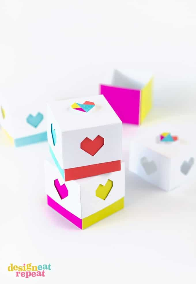 Package your Valentine's Day candy in these colorful (mini!) printable heart boxes for a unique spin on the traditional red heart box!