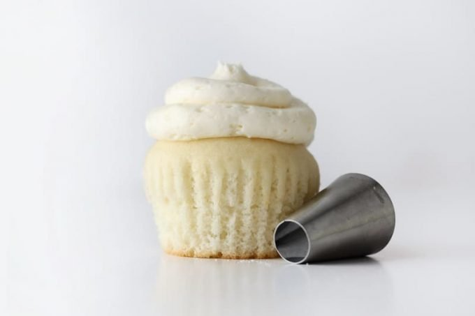 White wedding cupcake with piping tip.