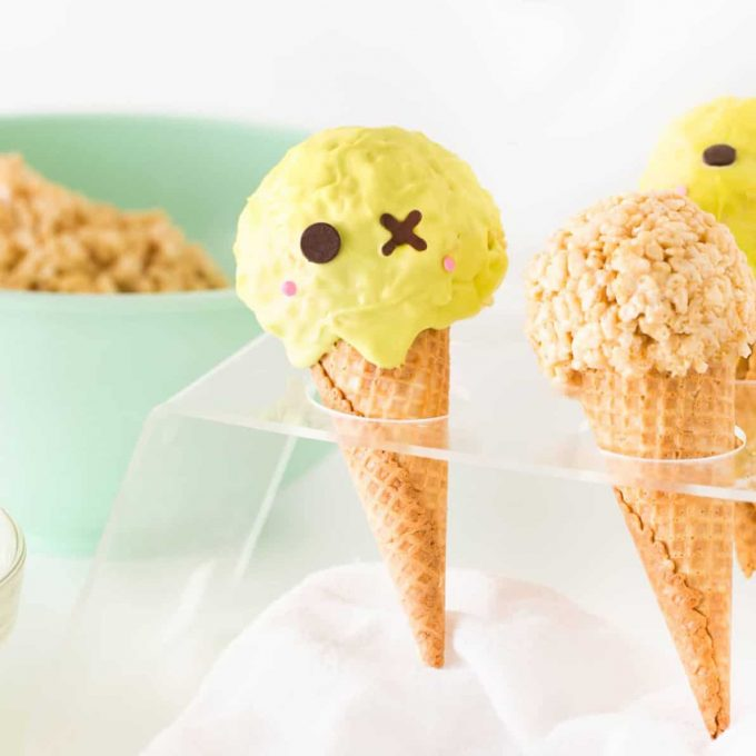 Rice krispie treats in ice cream cones decorated like zombie